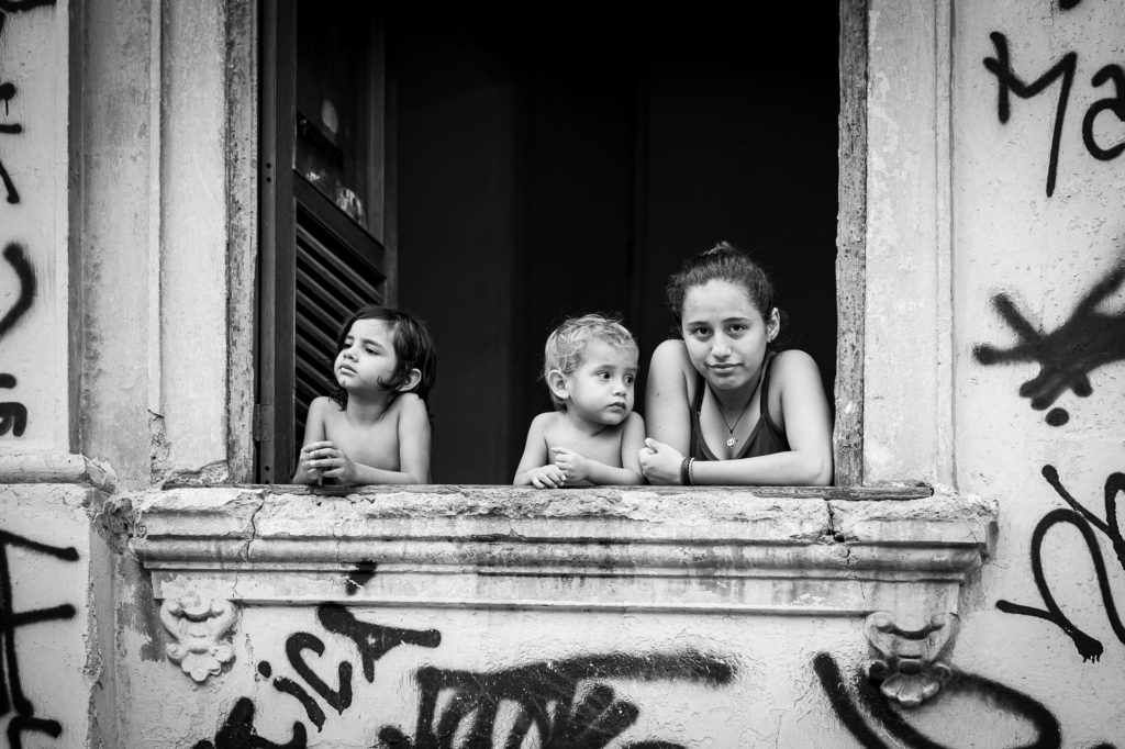 Family looking out of the window in Rio